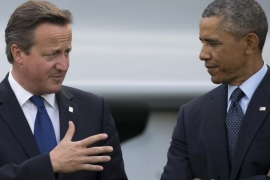 FILE – This is a Friday, Sept. 5, 2014 file photo of U.S. President Barack Obama, right, as he speaks with British Prime Minister David Cameron during a flypast at the NATO summit at the Celtic Manor Resort in Newport, Wales. The British press on Friday March 11, 2016 has accused President Obama of launching a verbal attack on Prime Minister David Cameron. Obama's comments in a magazine interview were called 'unprecedented' and 'extraordinary.' The hubbub has pushed the White House into damage control mode and US officials issued a statement asserting close ties between the leaders. (AP Photo/Jon Super, File)