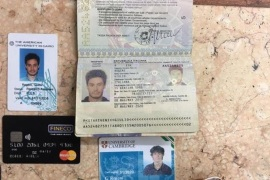 FILE — In this  file photo released by the Egyptian Ministry of Interior on Thursday, Mar. 24, 2016, personal belongings of slain Italian graduate student Giulio Regeni, including his passport, are displayed. On Sunday, April 3, 2016 the editor of Egypt's top state newspaper called on Egyptian authorities to seriously deal with the case of an Italian student tortured and killed in Cairo, saying officials who didn't realize the gravity of the case are risking Egyptian-Italian relations. Italian Premier Matteo Renzi has insisted Italy will settle for nothing less than the truth. (Egyptian Interior Ministry via AP, File)