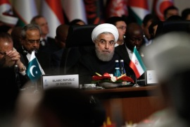 Iran's President Hassan Rouhani looks around as the leaders and representatives of the Islamic countries gather for the 13th Organization of Islamic Cooperation, OIC, Summit in Istanbul, Thursday, April 14, 2016. Turkish President Recep Tayyip Erdogan says Muslim nations have agreed to establish a joint body to fight terrorism and urged the countries' leaders to examine the root causes of the migration crisis. Addressing the summit of the OIC in Istanbul on Thursday, he stressed terrorism is the largest problem confronting the Muslim world.(AP Photo/Emrah Gurel)