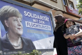 People walk in front of billboards with the picture of German Chancellor Angela Merkel with the words; 'Solidarity with the refugees', in Gaziantep, Turkey, 23 April 2016. German Chancellor Angela Merkel will visit refugee camps in Nizip district near Gaziantep on 23 April 2016.