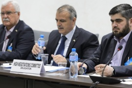 Syrian opposition body (HCN) delegation member George Sabra (L-R), delegation head Asaad al-Zoabi and Chief negotiator, Army of Islam rebel group's Mohammed Alloush, attend a meeting on Syria peace talks with UN Syria Envoy at the European headquarters of the United Nations in Geneva, Switzerland, 15 April 2016. Delegations met for a fresh rounds of intra-Syrian peace talks.