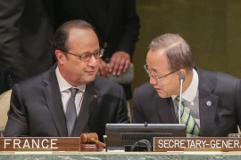 French President Francois Hollande (L) talks with United Nations Secretary-General Ban Ki-moon (R) during the opening ceremony of the High-Level Event for the Signature of the Paris Agreement at  the United  Nations Headquarters in New York, New York USA, 22 April 2016.