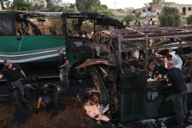Israeli police officers work at the scene of a bus explosion in Jerusalem, Monday, April 18, 2016.  A bus exploded in the heart of Jerusalem Monday, wounding at least 15 people who appeared to have been in an adjacent bus that was also damaged. The explosion raised fears of a return to the Palestinian suicide attacks that ravaged Israeli cities a decade ago. (AP Photo/Oded Balilty)