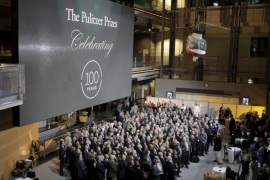 The largest-ever gathering of Pulitzer Prize recipients pose for a photograph during a celebration honoring the centennial of the Pulitzer Prize at the Newseum in Washington January 28, 2016.  REUTERS/Joshua Roberts