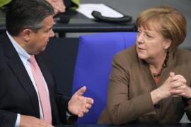 German Chancellor Angela Merkel (R) and German Minister of Economic Affairs and Vice-Chancellor Sigmar Gabriel (L) discuss in the government's bench during a session of the German 'Bundestag' parliament, in Berlin, Germany, 14 April 2016.