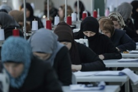 Syrian refugee women train during a sewing workshop at the Oncupinar refugee camp for Syrian refugees next to the border crossing with Syria, near the town of Kilis in southeastern Turkey, Thursday, March 17, 2016. Nearly 300,000 are housed in 26 government-run camps similar to this one. The European Union and Turkey hope to reach a comprehensive deal this week to tackle illegal migration and the refugee crisis spurred by conflicts in Syria and beyond. In return for its efforts, Turkey stands to gain 3.3 billion US dollars in EU funding to help it improve the situation of the 2.7 million Syrian refugees already within its borders. (AP Photo/Lefteris Pitarakis)
