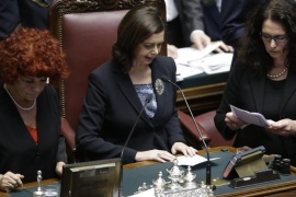 Lower chamber president Laura Boldrini, center, reads ballots at the end of a voting session for the election of the new Italian President, at the lower chamber, in Rome, Saturday, Jan. 31, 2015. Italian lawmakers vote again to elect the country's next president. Premier Matteo Renzi has urged his oft-divisive Democrats and government allies to unify behind his pick, Constitutional Court justice Sergio Mattarella, in Saturday's balloting. After two days of inconclusive balloting, the threshold for election dropped from a two-thirds majority to a simple majority. (AP Photo/Andrew Medichini)