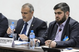 Syrian opposition body (HCN) delegation member George Sabra, delegation head Asaad al-Zoabi and Chief negotiator, Army of Islam rebel group's Mohammed Alloush, from left, attend a meeting on Syria peace talks with UN Syria Envoy at the United Nations office on Friday, April 15, 2016, in Geneva, Switzerland. (Fabrice Coffrini/Pool Photo via AP)