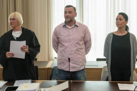 Lutz Bachmann (C), co-founder of Patriotic Europeans Against the Islamisation of the West (PEGIDA), stands between his attorney Katja Reichel (L) and his wife Vicky Bachmann (R), during a start of his trial in Dresden, Germany, 03 May 2016. The public prosecutor's office has charged 43-year-old Bachmann with incitement of hatred over Facebook posts on refugees from September 2014.
