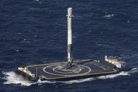 A handout picture made available on 11 April 2016 shows the main-stage booster of a SpaceX Falcon 9 rocket landing on a platform at sea in the Atlantic Ocean, USA, 09 April 2016. Private firm SpaceX successfully launched its Dragon spacecraft to supply the astronauts on the International Space Station (ISS) with supplies and scientific equipment on 09 April 2016. The spacecraft was placed into orbit from Cape Canaveral, Florida. After Dragon was in orbit and was routed to the ISS, SpaceX achieved for the first time the successful landing of the Falcon 9 rocket on a floating platform for drones approximately the size of a football field located in the Atlantic Ocean. The platform is named 'Of Course, I Still Love You' in reference to one of the ships in the science fiction novel 'The Player of Game' by Scottish writer Iain M. Banks.  EPA/SPACEX