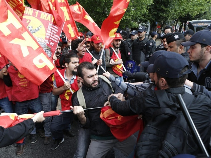 Protestors clash with riot police as they try to reach Taksim Square for an illegal May day celebration in Istanbul, Turkey 01 May 2016. Labour Day or May Day is observed all over the world on the first day of the May to celebrate the economic and social achievements of workers and fight for labourers rights.