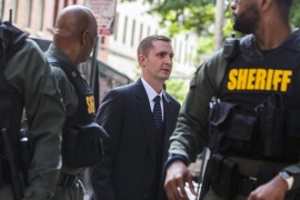 Baltimore police officer Edward Nero (C-R), faced with multiple charges in the death of Freddie Gray, enters the Baltimore court house for his expected verdict in Baltimore, MD, USA, 23 May 2016. Freddie Gray died on 19 April 2015 when he sustained a spinal injury in the back of a Baltimore police van.