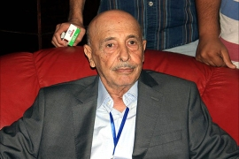 epa04341540 A picture made available on 05 August 2014 shows the newly elected speaker of the Libyan House of Representatives Akila Saleh Issa (C), Tobruk, Libya, 04 August 2014. Amid the escalating conflict across the country the Islamist dominated Libyan General National Congress (GNC) has handed over power to the Libyan House of Representatives, which held its first meeting 02 August, began the process of swearing in its members and elected its new speaker early 05 August, according to local media.  EPA