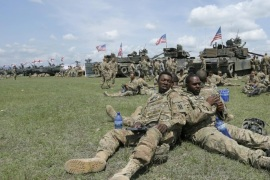 US servicemen take a rest before the official opening ceremony of the joint military exercise 'Noble Partner 2016' with troops from Georgia, the USA and Britain at the military base of Vaziani outside Tbilisi, Georgia, 11 May 2016. The 'Noble Partner 2016' exercise according to the U.S. Army in Europe includes approximately 500 Georgian, 150 United Kingdom and 650 U.S. service members and runs from 11 to 26 May 2016 and is aimed at enhancing the U.S. and Georgian NATO Response Force (NRF) interoperability.
