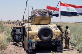 Iraqi military trucks take up position during a military operation southwest of Fallujah city, western Iraq on 25 May 2016. The Iraqi Army on 23 May began an offensive to take back the city of Fallujah, located around 50 kilometers east of Baghdad in the western province of Al Anbar, from the hands of the Islamic State (IS).