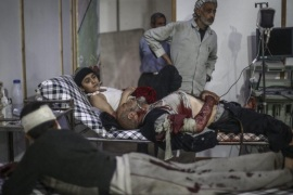 Syrians receive first aid in a field hospital following an airstrike by forces loyal to the Syrian government in the rebel-held area of Douma, outskirts of Damascus, Syria, 10 November 2015. According to the opposition, at least ten civilians were killed in Syrian regime strikes on the rebel-held Douma on 10 November.  EPA/MOHAMMED BADRA ATTENTION EDITORS: PICTURE CONTAINS GRAPHIC CONTENT