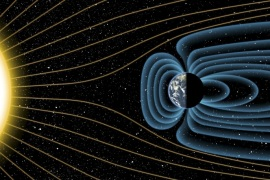 An artist's depiction of Earth's magnetic field deflecting high-energy protons from the sun four billion years ago, is shown in this image released on July 30, 2015. The relative sizes of the Earth and Sun, as well as the distances between the two bodies, are not drawn to scale in this drawing. Earth's magnetic field has been a life preserver, protecting against relentless solar winds – streams of charged particles rushing from the Sun – that otherwise could strip aw