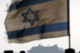 An Israeli flag flutters in the wind as a naval vessel (not seen) escorts the Mavi Marmara, a Gaza-bound ship that was raided by Israeli marines, to the Ashdod port, in this May 31, 2010 file picture. Israeli Prime Minister Benjamin Netanyahu apologised on March 22, 2013 to Turkey for errors that might have led to the deaths of nine Turkish activists during a 2010 raid on a boat off the Gaza Strip, his office said in a statement. Picture taken May 31, 2010. REUTERS/Amir Cohen/File (ISRAEL – Tags: POLITICS CIVIL UNREST)