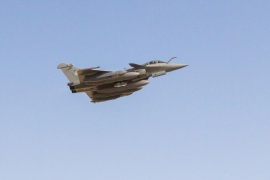 A French Rafale fighter jet, carrying cruise missiles, flies on a mission from an undisclosed base in the United Arab Emirates, December 15, 2015, in this photo distributed by ECPAD December 16, 2015. SCALP long-range missiles were launched on Tuesday from French fighter jets based in the United Arab Emirates and Jordan as part of a bombing raid that targeted a command center, training site and logistics depot in western Iraq on the border with Syria.    REUTERS/ECPAD-French Defence Ministry/Handout via Reuters ATTENTION EDITORS – THIS IMAGE HAS BEEN SUPPLIED BY A THIRD PARTY. REUTERS IS UNABLE TO INDEPENDENTLY VERIFY THE AUTHENTICITY, CONTENT, LOCATION OR DATE OF THIS IMAGE. THIS PICTURE IS DISTRIBUTED, EXACTLY AS RECEIVED BY REUTERS, AS A SERVICE TO CLIENTS.  FOR EDITORIAL USE ONLY. NOT FOR SALE FOR MARKETING OR ADVERTISING CAMPAIGNS. NO RESALES. NO ARCHIVE. IT IS DISTRIBUTED, EXACTLY AS RECEIVED BY REUTERS, AS A SERVICE TO CLIENTS
