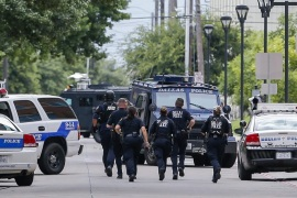 Heavily-armed Dallas Police Department officers investigate a 'credible threat' at the department's headquarters in Dallas, Texas, USA, 09 July 2016. Five officers died and seven were injured after an ambush assault by a gunman during a protest rally in Dallas on 07 July.