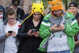 (FILE) A file picture dated 11 July 2016 shows people playing the new game 'Pokemon Go' on their smartphone in Leerdam, The Netherlands. According to reports, shares of Japanese multinational consumer electronics and software company Nintendo soared by 16 percent at the Tokyo Stock Exchange on 14 July 2016, given to the success of its new smartphone game 'Pokemon Go.' The shares of the company, which is headquartered in Kyoto, Japan, reached 244 US dollar during the first half of the trading day at the Tokyo exchange, media added. Pokemon Go, a Global Positioning System (GPS) based augmented reality mobile game, launched first on 06 July in the US.