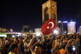 Supporters of President of Turkey Recep Tayyip Erdogan shout slogans at the Taksim Square in Istanbul, Turkey, 16 July 2016. Turkish Prime Minister Yildirim reportedly said that the Turkish military was involved in an attempted coup d'etat. The Turkish military meanwhile stated it had taken over control.