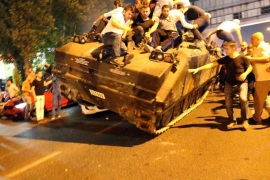 People occupy a tank in Istanbul, Turkey, 16 July 2016. Turkish Prime Minister Yildirim reportedly said that the Turkish military was involved in an attempted coup d'etat. The Turkish military meanwhile stated it had taken over control.
