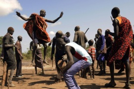 Cattle keepers from the Dinka tribe perform a traditional dance after a prayer session for peace and good health along the route to Rajaf Payam outside the capital Juba October 18, 2014. Picture taken October 18, 2014. REUTERS/Jok Solomon (SOUTH SUDAN – Tags: SOCIETY AGRICULTURE ANIMALS TPX IMAGES OF THE DAY)