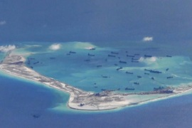 Chinese dredging vessels are purportedly seen in the waters around Mischief Reef in the disputed Spratly Islands in the South China Sea in this still image from video taken by a P-8A Poseidon surveillance aircraft provided by the United States Navy May 21, 2015.  U.S. Navy/Handout via Reuters/File Photo  ATTENTION EDITORS – THIS PICTURE WAS PROVIDED BY A THIRD PARTY. REUTERS IS UNABLE TO INDEPENDENTLY VERIFY THE AUTHENTICITY, CONTENT, LOCATION OR DATE OF THIS IMAGE. THI