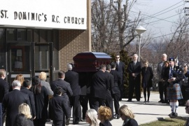 The casket of journalist Marie Colvin is carried into her funeral service at St. Dominic's Church in Oyster Bay, New York, March 12, 2012. Colvin's final dispatch, published just three days before she and a French photographer were killed by shell and rocket fire, came from a bleak cellar packed with women and children cowering in the besieged Syrian city of Homs.