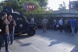 A still image from video shows armoured police vehicle and people waiting outside TRT state television after a failed coup attempt by Turkish soldiers, in Istanbul, Turkey July 16, 2016.   REUTERS/via Reuters TV