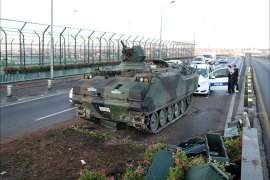 epa05427268 Vehicles drive by Turkish army tanks on a road in Istanbul, Turkey, 16 July 2016. Turkish Prime Minister Yildirim reportedly said that the Turkish military was involved in an attempted coup d'etat. The Turkish military meanwhile stated it had taken over control.  EPA/TOLGA BOZOGLU