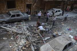 A handout photograph released by the official Syrian Arab News Agency (SANA) shows people inspecting a residential neighborhood after rocket shells attack, in the government-held area of Aleppo, Syria, 11 July 2016. According to SANA, eight people were killed after rocket shells allegedly fired by rebels hit residential neighborhoods in Aleppo.  EPA/SANA HANDOUT