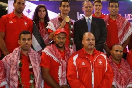 Prince Faisal Bin Al Hussein, President of the Jordanian Olympic Committee (top C), poses with of Ahmad Abughaush, who won a Taekwondo gold claiming Jordan's first ever Olympic medal, and the members of the Jordanian mission for the Olympics after their arrival at the Queen Alia International Airport in Amman, Jordan, August 23, 2016. REUTERS/Muhammad Hamed