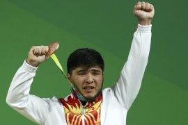 2016 Rio Olympics – Weightlifting – Men's 69kg Victory Ceremony – Riocentro – Pavilion 2 – Rio de Janeiro, Brazil – 09/08/2016. Izzat Artykov (KGZ) of Kyrgyzstan poses with his medal. REUTERS/Yves Herman FOR EDITORIAL USE ONLY. NOT FOR SALE FOR MARKETING OR ADVERTISING CAMPAIGNS.