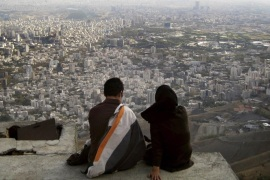 An Iranian couple sit overlooking the city of Tehran, in this October 19, 2006 file photo. The divorce rate in Iran is soaring. Since 2006, the rate of divorce has increased more than one a half times to the point where around 20 percent of marriages now end in divorce. In the first two months of this Iranian calendar year (late March to late May 2014) alone, more than 21,000 divorce cases were logged, according to official statistics. The rise in the number of couples