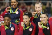 2016 Rio Olympics – Artistic Gymnastics – Final – Women's Team Victory Ceremony – Rio Olympic Arena – Rio de Janeiro, Brazil – 09/08/2016. Simone Biles (USA) of USA (L), Gabrielle Douglas (USA) of USA (Gabby Douglas) (top L), Laurie Hernandez (USA) of USA (C), Madison Kocian (USA) of USA (top R), Alexandra Raisman (USA) of USA (Aly Raisman) (R) pose with their gold medals on the podium after winning the women's team final.   REUTERS/Mike Blake TPX IMAGES OF THE DAY. F