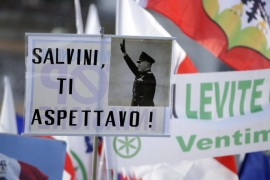 "A placard reading ""Salvini, expecting you,"" with a picture of Italian wartime dictator Benito Mussolini, is held up at a rally held by Northern League party leader Matteo Salvini in Rome, February 28, 2015. REUTERS/Max Rossi (ITALY – Tags: POLITICS CIVIL UNREST)"
