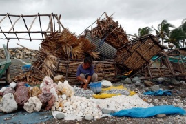 A woman sorts decorative rocks outside her shop toppled during Typhoon Haima, in Pasuiquin, Ilocos Norte in northern Philippines, October 20, 2016. REUTERS/Erik De Castro