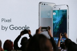 Attendees take pictures of the stage during the launch of the Google Pixel phone at a Google product event in San Francisco, California, USA, 04 October 2016.
