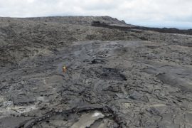 A handout image, dated 29 July 2016, issued by the U.S. Geological Survey, USGS, showing Hawaiian Volcano Observatory, HVO, geology field crew (C) gathering data near the lava flow vent on the eastern flank of current lava flow from Mount Kilauea eruption, Hawaii, USA. Authorities have confirmed current lava flow poses no threat for public.  EPA/USGS / HANDOUT