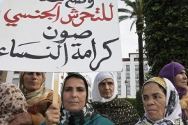 "Women from various regions of Morocco hold placards as they protest against violence towards women, in Rabat November 24, 2013. The placard reads, ""Stopping harassment gives dignity for women"".   REUTERS/Youssef Boudlal   (MOROCCO – Tags: CIVIL UNREST SOCIETY POLITICS)"
