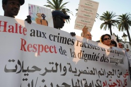 Activists demonstrate against racism in front of the Moroccan parliament in Rabat, Morocco, 11 September 2014. Protesters gathered after the sixth recent death of an immigrant in the country. Charles Ndou, a Senegalese migrant, was stabbed to death by a mob in Tangiers on 30 August 2014.
