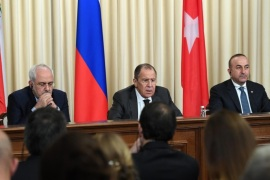 Iranian Foreign Minister Mohammad Javad Zarif, Russian Foreign Minister Sergei Lavrov and Turkish Foreign Minister Mevlut Cavusoglu attend a press conference in Moscow, Russia, 20 December 2016. Russia, Iran and Turkey agreed to guarantee Syria peace talks and backed expanding a ceasefire in the war-torn country, Russian foreign minister said after talks with counterparts.