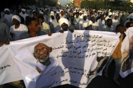 People carry banners during the funeral of Popular Congress Party (PCP) leader Hassan al-Turabi in Khartoum March 6, 2016. REUTERS/Mohamed Nureldin Abdallah