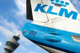 The tail of a Royal Dutch Airways (KLM) aircraft sits in front of a control tower at Schiphol airport near Amsterdam, The Netherlands, 16 October 2014. Camiel Eurlings has resigned as CEO of KLM and will be succeeded by his deputy Pieter Elbers, though the company has so far not made a statement as to the cause of Eurlings departure, Eurling has stated that the €500m costs of the strikes recently experienced by Air France, a company with which KLM merged in 2004, should