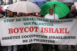 Demonstrators hold a rally in solidarity with Palestinians near the Egmont Palace, which houses the Belgian Ministry of Foreign Affairs, in Brussels, Belgium, 06 August 2014. The banner reads 'Boycott Israel, Stop the Israeli Occupation of Palestine'. Israeli and Egyptian officials held several hours of talks on a long-term Gaza truce late on 05 August after a three-day ceasefire went into effect and the last Israeli soldiers pulled out of the Palestinian enclave. Dur