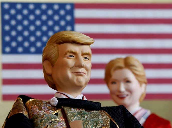 Japanese doll-maker Kyugetsu Inc's dolls depicting U.S. President Donald Trump (L) and former Democratic presidential nominee Hillary Clinton, as part of a traditional set of Japanese ornamental hina dolls used in Japan to celebrate Girls' Day, are pictured at the company's main shop in Tokyo, Japan, January 26, 2017.  REUTERS/Toru Hanai     FOR EDITORIAL USE ONLY. NO RESALES. NO ARCHIVES.