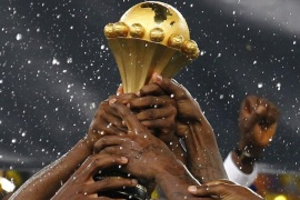 (FILES) A file picture dated 10 February 2013 of Nigerian national soccer team players celebrating with the Africa Cup trophy after winning the final against Burkina Faso at the Soccer City Stadium in Johannesburg, South Africa. Morocco will no longer host the Africa Cup of Nations early next year and its team has been disqualified, the African Football Confederation CAF said 11 November 2014. It follows CAF's decision to refuse a request from the Moroccan government t