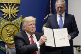 US President Donald J. Trump signs Executive Orders in the Hall of Heroes at the Pentagon in Arlington, Virginia, USA, 27 January 2017, as newly sworn-in US Secretary of Defense James Mattis (R) looks on.